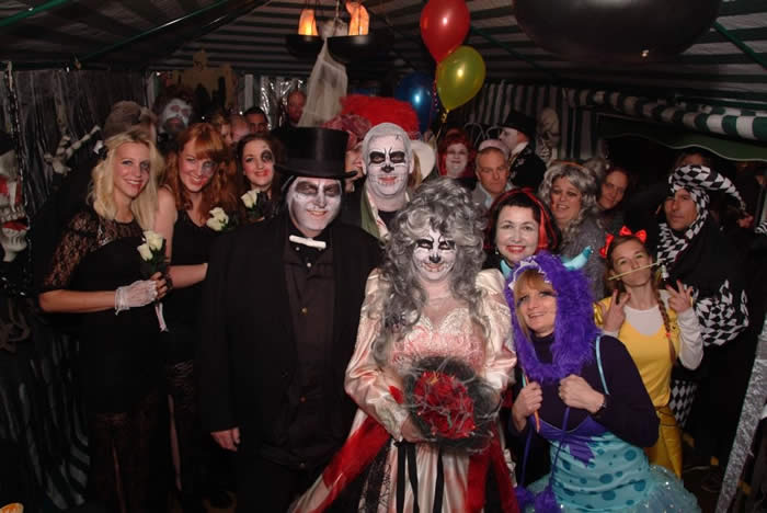 Family wedding foto at the Dead Wedding Party in Chelmsford, Essex with the Father of the Bride as the Fire Breather